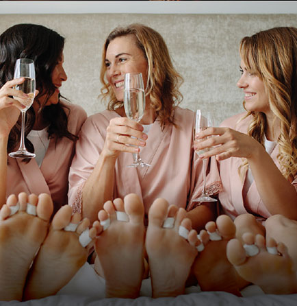three women enjoying champagne