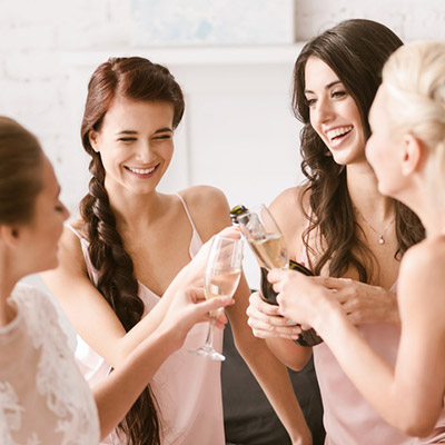 women toasting champagne